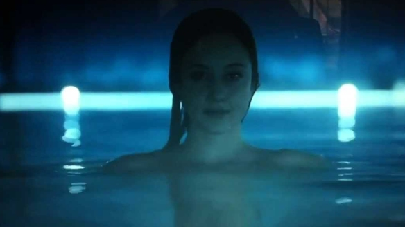 Andrea Louise Riseborough naked bum sinks into see through pool, what a beauty.