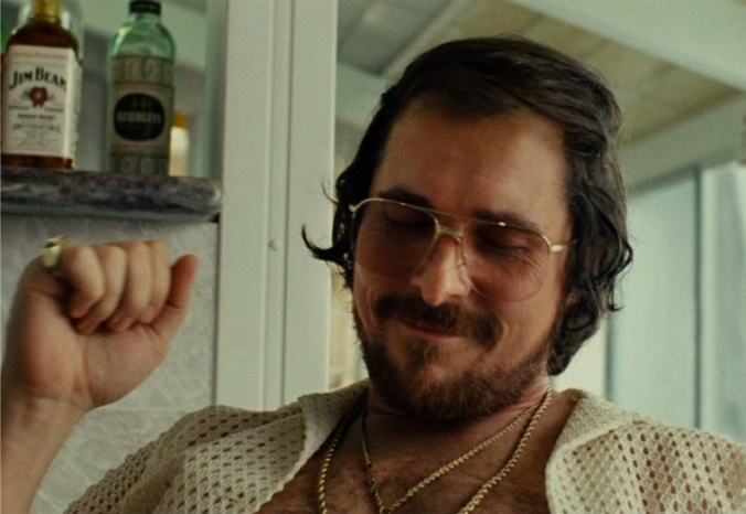 American-Hustle Bale as Irving, the magic combover.