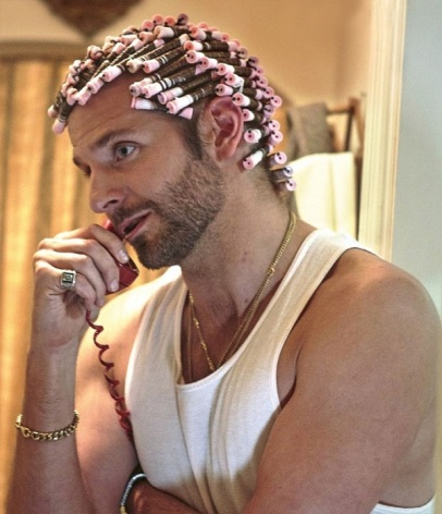 Bradley Cooper in a pink perm.