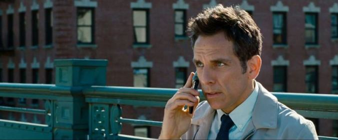 The-Secret-Life-of-Walter-Mitty-Movie-Review-Stiller uses a cell before getting on train to work.
